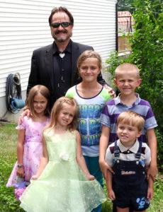 Powell with his children, Ember Rain 11, Emmanuel 9, Helen 7, twins Samuel and Eowyn 5.